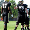 "University of Colorado's Jack Harris, No. 75, points at teammate Stephane Nembot during fall football camp at the CU practice field on Wednesday, Aug. 8. For more photos of the practice go to  <a href=""http://www.dailycamera.com"">http://www.dailycamera.com</a><br /> Jeremy Papasso/ Camera"