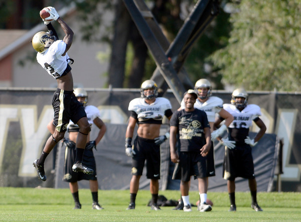 "University of Colorado's Kenneth Crawley makes a jumping catch during fall football camp at the CU practice field on Wednesday, Aug. 8. For more photos of the practice go to  <a href=""http://www.dailycamera.com"">http://www.dailycamera.com</a><br /> Jeremy Papasso/ Camera"