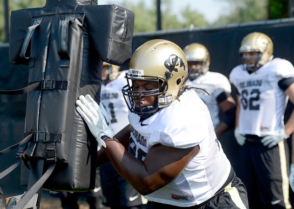 "University of Colorado's Nate Bonsu hits the sled during fall football camp at the CU practice field on Wednesday, Aug. 8. For more photos of the practice go to  <a href=""http://www.dailycamera.com"">http://www.dailycamera.com</a><br /> Jeremy Papasso/ Camera"