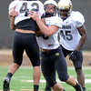 "University of Colorado's Scotty Jarvis hits K.T. Tu'umalo, No, 42, during the fall football camp on Monday, Aug. 13, at the CU Practice Fields in Boulder. For more photos of the practice go to  <a href=""http://www.dailycamera.com"">http://www.dailycamera.com</a><br /> Jeremy Papasso/ Camera"