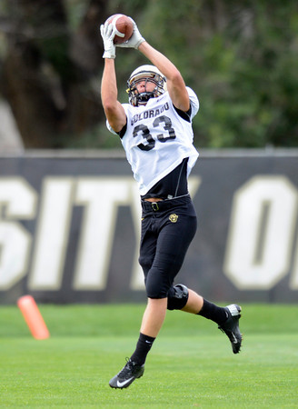 "University of Colorado's Richard Yates makes a catch during the fall football camp on Monday, Aug. 13, at the CU Practice Fields in Boulder. For more photos of the practice go to  <a href=""http://www.dailycamera.com"">http://www.dailycamera.com</a><br /> Jeremy Papasso/ Camera"