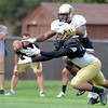 "University of Colorado's Vincent Hobbs, front, and Woodson Greer III fight for the ball during the fall football camp on Monday, Aug. 13, at the CU Practice Fields in Boulder. For more photos of the practice go to  <a href=""http://www.dailycamera.com"">http://www.dailycamera.com</a><br /> Jeremy Papasso/ Camera"