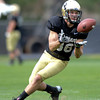 "University of Colorado's Alex Turbow makes a catch during the fall football camp on Monday, Aug. 13, at the CU Practice Fields in Boulder. For more photos of the practice go to  <a href=""http://www.dailycamera.com"">http://www.dailycamera.com</a><br /> Jeremy Papasso/ Camera"