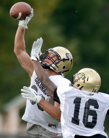 "University of Colorado's Richard Yates catches a pass over Jeffrey Hall during a defensive backs drill during the Fall Football Camp on Wednesday, Aug. 15, at the CU Practice Fields in Boulder. For more photos of the practice and a video interview with Jon Embree and Jordan Webb go to  <a href=""http://www.dailycamera.com"">http://www.dailycamera.com</a><br /> Jeremy Papasso/ Camera"