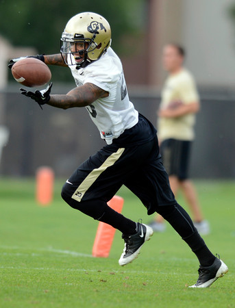 "University of Colorado's Sherrard Harrinton makes a catch during the Fall Football Camp on Wednesday, Aug. 15, at the CU Practice Fields in Boulder. For more photos of the practice and a video interview with Jon Embree and Jordan Webb go to  <a href=""http://www.dailycamera.com"">http://www.dailycamera.com</a><br /> Jeremy Papasso/ Camera"