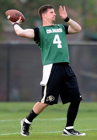 "University of Colorado starting quarterback Jordan Webb throws the ball during the Fall Football Camp on Wednesday, Aug. 15, at the CU Practice Fields in Boulder. For more photos of the practice and a video interview with Jon Embree and Jordan Webb go to  <a href=""http://www.dailycamera.com"">http://www.dailycamera.com</a><br /> Jeremy Papasso/ Camera"