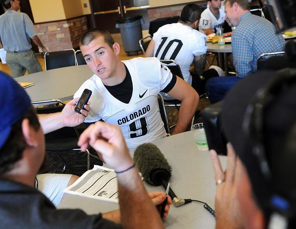 QB Tyler Hansen talks to the press during media day.<br /> Cliff Grassmick / August 7, 2010