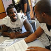 Toney Clemons talks to Anthony Perkins during media day.<br /> Cliff Grassmick / August 7, 2010
