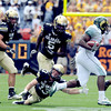 "Parker Orms of CU tries to get to the CSU running back.<br /> For more photos of the CU game, go to  <a href=""http://www.dailycamera.com"">http://www.dailycamera.com</a>.<br />  Cliff Grassmick / September 17, 2011"