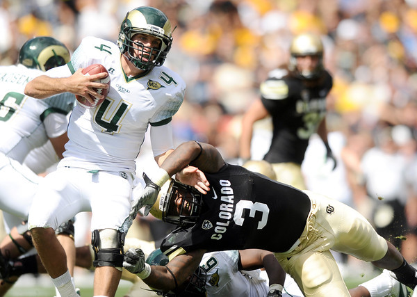 "Colorado State University quarterback Pete Thomas shakes a tackle from Douglas Rippy during a football game against the University of Colorado on Saturday, Sept. 17, at Sports Authority Field in Denver. CU defeated Colorado State 28-14. For more photos of the game go to  <a href=""http://www.dailycamera.com"">http://www.dailycamera.com</a><br /> Jeremy Papasso/ Camera"