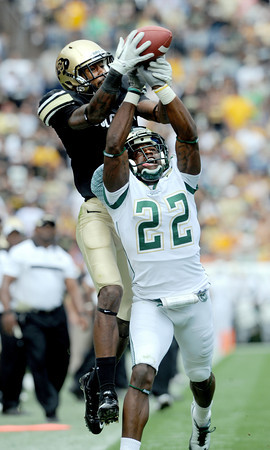 """Paul Richardson of CU, gets the ball knocked away by Elijah-Blu Smith of CSU.<br /> For more photos of the CU game, go to  <a href=""""http://www.dailycamera.com"""">http://www.dailycamera.com</a>.<br />  Cliff Grassmick / September 17, 2011"""