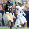 "Toney Clemons of CU walks into the endzone past Austin Gray of CSU.<br /> For more photos of the CU game, go to  <a href=""http://www.dailycamera.com"">http://www.dailycamera.com</a>.<br />  Cliff Grassmick / September 17, 2011"