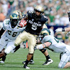 "Rodney Stewart of CU breaks away from CSU defenders in the Buffs win.<br /> For more photos of the CU game, go to  <a href=""http://www.dailycamera.com"">http://www.dailycamera.com</a>.<br />  Cliff Grassmick / September 17, 2011"