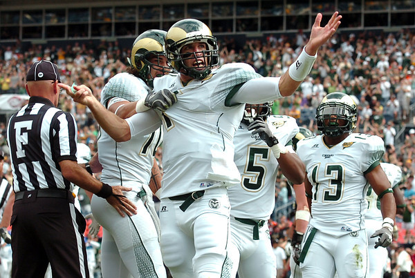 "Colorado State University quarterback Pete Thomas celebrates in the endzone after scoring a touchdown in the first quarter during a football game against Colorado State University on Saturday, Sept. 17, at Sports Authority Field in Denver. CU defeated CSU 28-14. For more photos of the game go to  <a href=""http://www.dailycamera.com"">http://www.dailycamera.com</a><br /> Jeremy Papasso/ Camera"