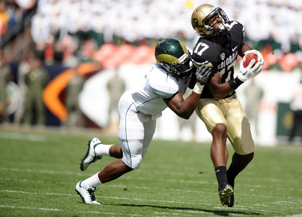 "University of Colorado wide receiver Toney Clemons gets tackled by Colorado State's Mike Orakpo during a football game against Colorado State University on Saturday, Sept. 17, at Sports Authority Field in Denver. For more photos of the game go to  <a href=""http://www.dailycamera.com"">http://www.dailycamera.com</a><br /> Jeremy Papasso/ Camera"