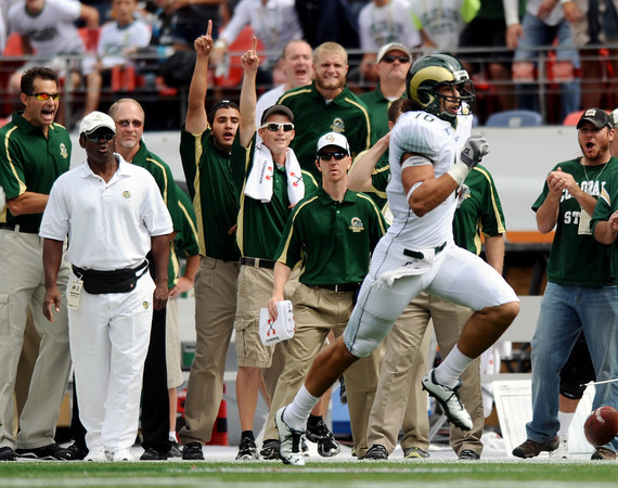 """Colorado State's Crockett Gillmore gains big yardage during a football game against the University of Colorado on Saturday, Sept. 17, at Sports Authority Field in Denver. CU defeated CSU 28-14. For more photos of the game go to  <a href=""""http://www.dailycamera.com"""">http://www.dailycamera.com</a><br /> Jeremy Papasso/ Camera"""