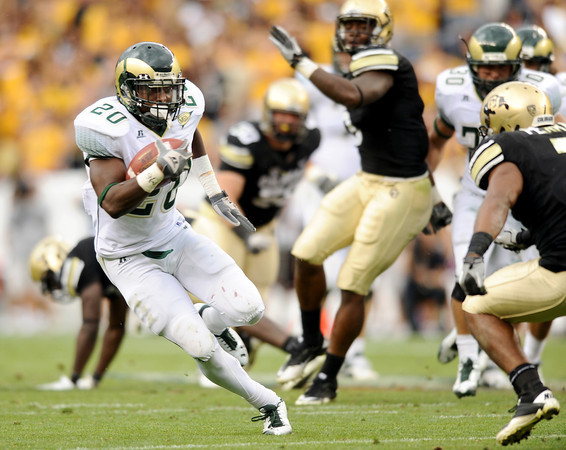 "Colorado State University running back Raymond Carter gains some yards during a football game against the University of Colorado on Saturday, Sept. 17, at Sports Authority Field in Denver. CU defeated CSU 28-14. For more photos of the game go to  <a href=""http://www.dailycamera.com"">http://www.dailycamera.com</a><br /> Jeremy Papasso/ Camera"