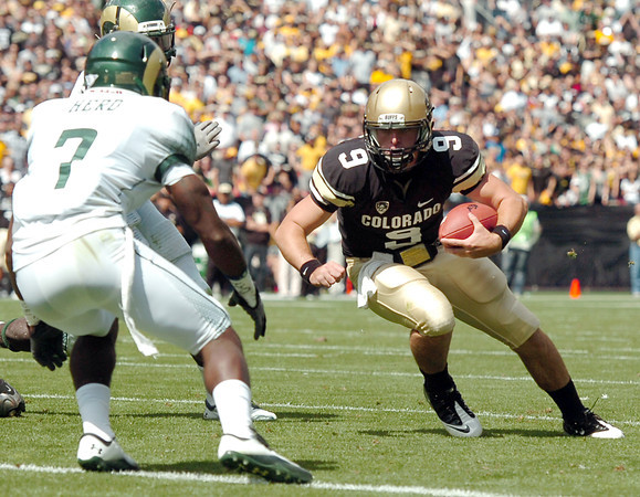 "University of Colorado's Tyler Hansen rushes in for a touchdown past Colorado State's Ivory Herd during a football game against Colorado State University on Saturday, Sept. 17, at Sports Authority Field in Denver. CU defeated CSU 28-14. For more photos of the game go to  <a href=""http://www.dailycamera.com"">http://www.dailycamera.com</a><br /> Jeremy Papasso/ Camera"