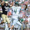"Jon Major of CU pressures Pete Thomas of CSU.<br /> For more photos of the CU game, go to  <a href=""http://www.dailycamera.com"">http://www.dailycamera.com</a>.<br />  Cliff Grassmick / September 17, 2011"