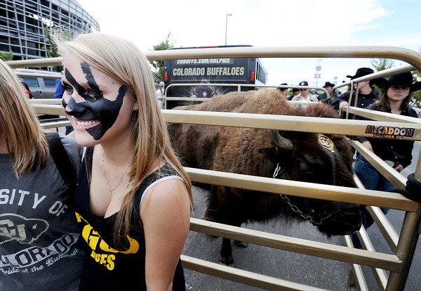 "Michelle Fay poses for a photo in front of Ralphie during the CU-CSU pregame tailgating at Sports Authority Field.<br /> For more photos of the CU game, go to  <a href=""http://www.dailycamera.com"">http://www.dailycamera.com</a>.<br />  Cliff Grassmick / September 17, 2011"