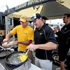 "Kris Shuter, left, and Ken Fugate are members of the ""Buffulance"" making breakfast during the CU-CSU pregame tailgating at Sports Authority Field.<br /> For more photos of the CU game, go to  <a href=""http://www.dailycamera.com"">http://www.dailycamera.com</a>.<br />  Cliff Grassmick / September 17, 2011"