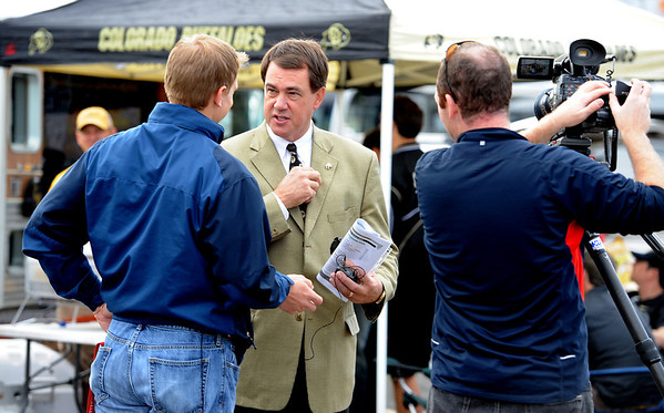 "CU Athletic Director, Mike Bohn talks to 9News during the CU-CSU pregame tailgating at Sports Authority Field.<br /> For more photos of the CU game, go to  <a href=""http://www.dailycamera.com"">http://www.dailycamera.com</a>.<br />  Cliff Grassmick / September 17, 2011"