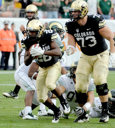 "Tony Jones of CU takes off on a run with help from Ryan Miller against CSU.<br /> For more photos of the CU game, go to  <a href=""http://www.dailycamera.com"">http://www.dailycamera.com</a>.<br />  Cliff Grassmick / September 17, 2011"