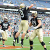 "Tyler Hansen of CU celebrates his second TD with Ryan Miller  against CSU.<br /> For more photos of the CU game, go to  <a href=""http://www.dailycamera.com"">http://www.dailycamera.com</a>.<br />  Cliff Grassmick / September 17, 2011"