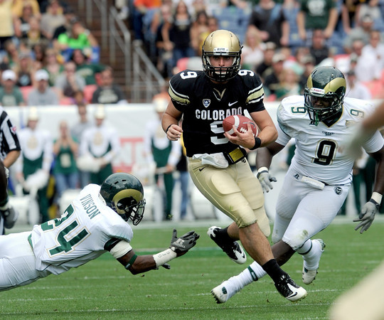 """CU QB, Tyler Hansen, eludes Dominique Vinson (24) of CSU.<br /> For more photos of the CU game, go to  <a href=""""http://www.dailycamera.com"""">http://www.dailycamera.com</a>.<br />  Cliff Grassmick / September 17, 2011"""