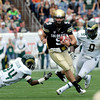 "CU QB, Tyler Hansen, eludes Dominique Vinson (24) of CSU.<br /> For more photos of the CU game, go to  <a href=""http://www.dailycamera.com"">http://www.dailycamera.com</a>.<br />  Cliff Grassmick / September 17, 2011"