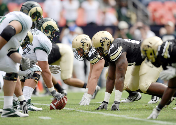 "University of Colorado's Conrad Obi, right center, lines upand gets ready for the snap during a football game against Colorado State University on Saturday, Sept. 17, at Sports Authority Field in Denver. CU defeated CSU 28-14. For more photos of the game go to  <a href=""http://www.dailycamera.com"">http://www.dailycamera.com</a><br /> Jeremy Papasso/ Camera"