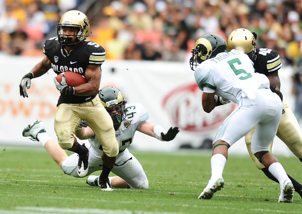 "University of Colorado's Rodney Stewart breaks a tackle from James Skelton during a football game against Colorado State University on Saturday, Sept. 17, at Sports Authority Field in Denver. CU defeated CSU 28-14. For more photos of the game go to  <a href=""http://www.dailycamera.com"">http://www.dailycamera.com</a><br /> Jeremy Papasso/ Camera"