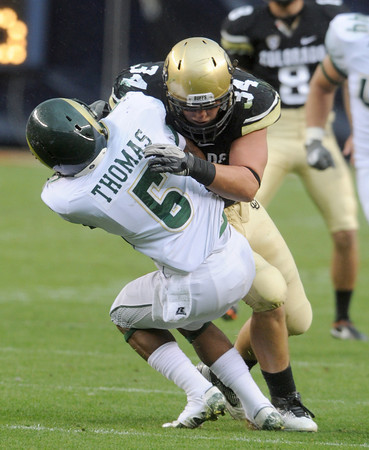 "Ryan Deehan of CU puts a hit on Momo Thomas of CSU.<br /> For more photos of the CU game, go to  <a href=""http://www.dailycamera.com"">http://www.dailycamera.com</a>.<br />  Cliff Grassmick / September 17, 2011"