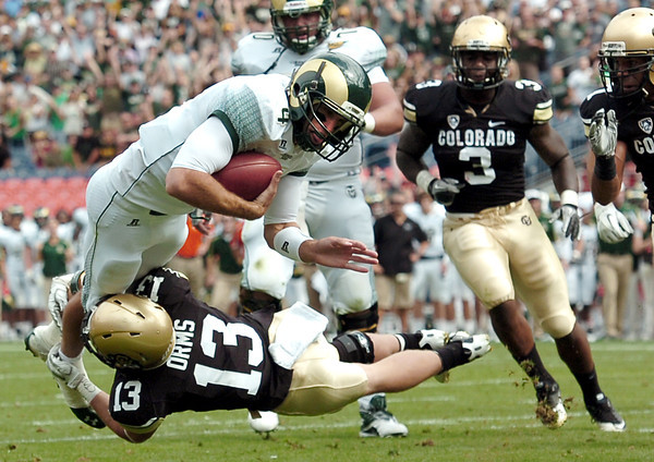 """Colorado State University quarterback Pete Thomas dives over Parker Orms for a touchdown during the Rocky Mountain Showdown on Saturday, Sept. 17, at Sports Authority Field in Denver. CU defeated CSU 28-14. For more photos of the game go to  <a href=""""http://www.dailycamera.com"""">http://www.dailycamera.com</a><br /> Jeremy Papasso/ Camera"""