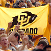 "University of Colorado football fans hold up a CU banner during a football game against Colorado State University on Saturday, Sept. 17, at Sports Authority Field in Denver. CU defeated CSU 28-14. For more photos of the game go to  <a href=""http://www.dailycamera.com"">http://www.dailycamera.com</a><br /> Jeremy Papasso/ Camera"