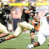 "University of Colorado's Anthony Perkins, center, tackles Chris Nwoke during a football game against Colorado State University on Saturday, Sept. 17, at Sports Authority Field in Denver. CU defeated Colorado State 28-14. For more photos of the game go to  <a href=""http://www.dailycamera.com"">http://www.dailycamera.com</a><br /> Jeremy Papasso/ Camera"