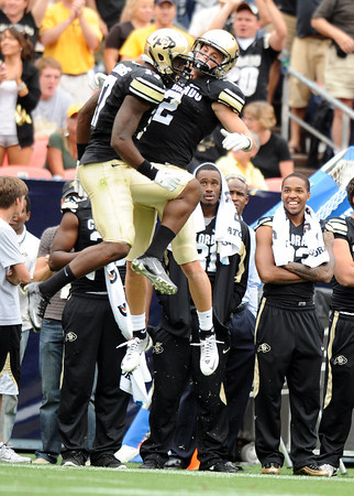 "University of Colorado's Toney Clemons, left, celebrates with teammate Logan Gray after scoring a touchdown during a football game against Colorado State University on Saturday, Sept. 17, at Sports Authority Field in Denver. CU defeated CSU 28-14. For more photos of the game go to  <a href=""http://www.dailycamera.com"">http://www.dailycamera.com</a><br /> Jeremy Papasso/ Camera"