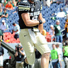 """CU QB, Tyler Hansen celebrates his TD run to give Colorado their first points against CSU.<br /> For more photos of the CU game, go to  <a href=""""http://www.dailycamera.com"""">http://www.dailycamera.com</a>.<br />  Cliff Grassmick / September 17, 2011"""