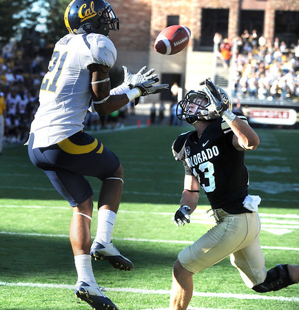 "Keenan Allen of Cal catches the winning touchdown over Parker Orms of Colorado in the overtime game in Boulder, Co.<br /> For more photos of the CU game, go to  <a href=""http://www.dailycamera.com"">http://www.dailycamera.com</a>.<br /> Paul Aiken / September 10, 2011"