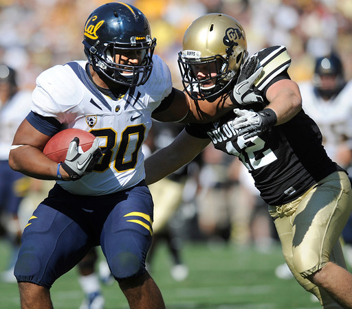 """Cal's Anthony Miller, 80, fights off CU's Patrick Mahnke, 12, for a touchdown catch and run during their game at Folsom Field in Boulder.<br /> For more photos of the CU game, go to  <a href=""""http://www.dailycamera.com"""">http://www.dailycamera.com</a>.<br /> Paul Aiken / September 10, 2011 / The Daily Camera"""