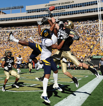 "CU'S Tyler McCulloch 87, and Cal's Marc Anthony, 2, battle for the ball late in the game at Folsom Field in Boulder.<br /> For more photos of the CU game, go to  <a href=""http://www.dailycamera.com"">http://www.dailycamera.com</a>.<br /> Paul Aiken / September 10, 2011 / The Daily Camera"