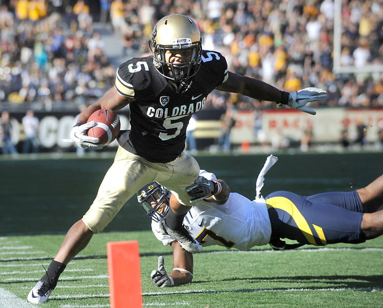 "CU's Rodney Stewart, 5,  can't stay in bounds after a long run as Cal's D.J. Campbell, 7, tries to slow him down in the fourth quarter  during their game at Folsom Field in Boulder.<br /> For more photos of the CU game, go to  <a href=""http://www.dailycamera.com"">http://www.dailycamera.com</a>.<br /> Paul Aiken / September 10, 2011 / The Daily Camera"