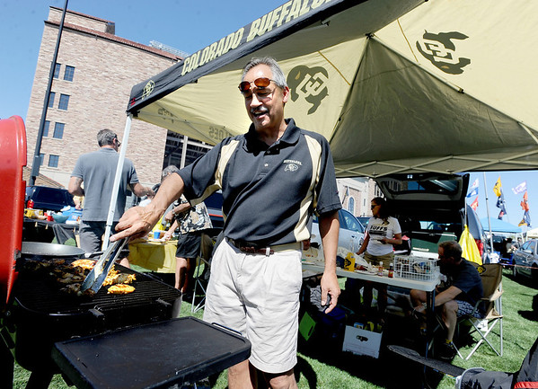 "Paul Gomez cooks up chicken a few hours before the Cal game on Saturday.<br /> For more photos of the CU game, go to  <a href=""http://www.dailycamera.com"">http://www.dailycamera.com</a>.<br />  Cliff Grassmick / September 10, 2011"