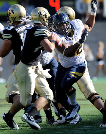 "Cal's Trevor Guyton makes a run at CU's Tyler Hansen during their game at Folsom Field in Boulder.<br /> For more photos of the CU game, go to  <a href=""http://www.dailycamera.com"">http://www.dailycamera.com</a>.<br /> Paul Aiken / September 10, 2011 / The Daily Camera"