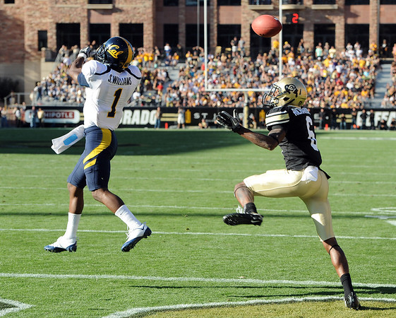 "Steve Williams of Cal, breaks up a potential touchdown pass to Paul Richardson late in the Buffs' loss.<br /> For more photos of the CU game, go to  <a href=""http://www.dailycamera.com"">http://www.dailycamera.com</a>.<br /> Cliff Grassmick / September 10, 2011"