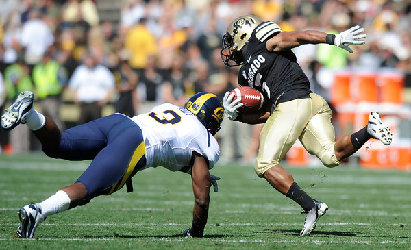 "Cal's D.J. Holt, misses a spinning Rodney Stewart 5,  in the game at Folsom Field in Boulder.<br /> For more photos of the CU game, go to  <a href=""http://www.dailycamera.com"">http://www.dailycamera.com</a>.<br /> Paul Aiken / September 10, 2011 / The Daily Camera"