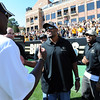 "Jashon Sykes, left, greets former Buffs, Chris Brown and Bobby Purify, both of the 2011 team.<br /> For more photos of the CU game, go to  <a href=""http://www.dailycamera.com"">http://www.dailycamera.com</a>.<br /> Cliff Grassmick / September 10, 2011"