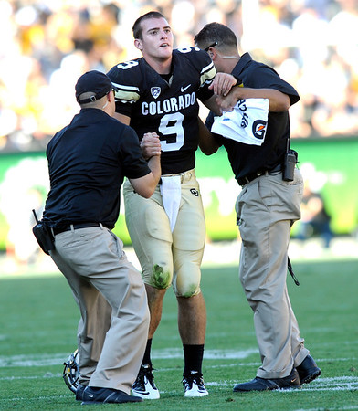 "CU'S Tyler Hansen is helped from the field late in the game at Folsom Field in Boulder.<br /> For more photos of the CU game, go to  <a href=""http://www.dailycamera.com"">http://www.dailycamera.com</a>.<br /> Paul Aiken / September 10, 2011 / The Daily Camera"