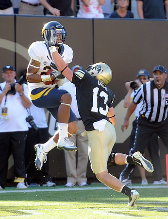 "Keenan Allen of Cal catches the winning touchdown over Parker Orms of Colorado in the overtime game in Boulder, Co.<br /> For more photos of the CU game, go to  <a href=""http://www.dailycamera.com"">http://www.dailycamera.com</a>.<br />  Cliff Grassmick / September 10, 2011"