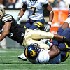 "CU's Rodney Stewart, 5, runs over Cal's DJ Holt, 3, during their game at Folsom Field on Saturday September 10, 2011. <br /> FOR MORE PHOTOS FROM THE GAME GO TO  <a href=""http://WWW.DAILYCAMERA.COM"">http://WWW.DAILYCAMERA.COM</a><br /> Photo by Paul Aiken / The Camera / September 10 2011"